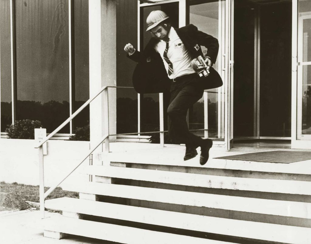 Historic image of Dave Huge leaping down steps
