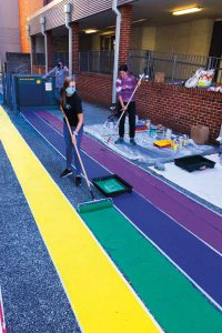 Students painting the rainbow